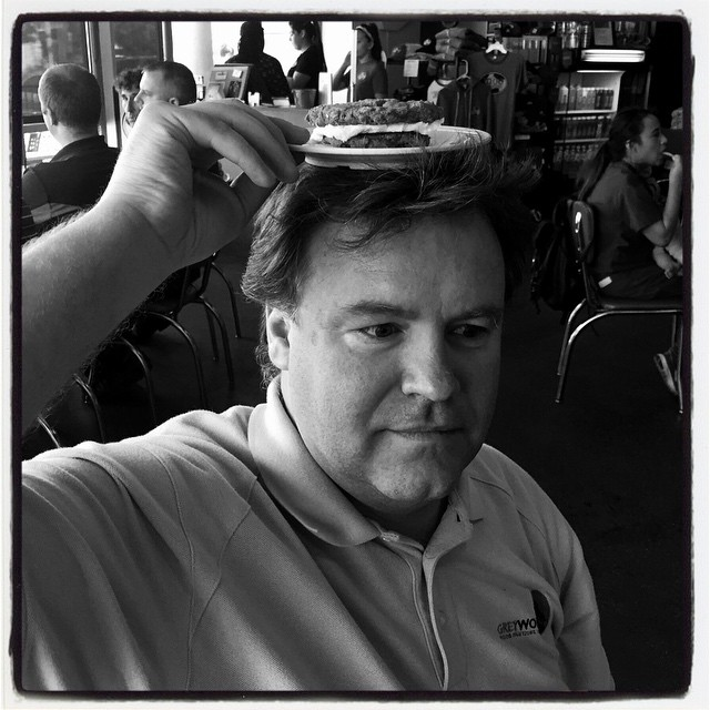 Man with cookie sandwich on his head. #iphoneography
