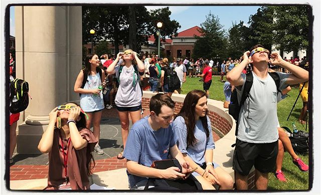 Watching the eclipse in front of the library. #olemiss #proflife